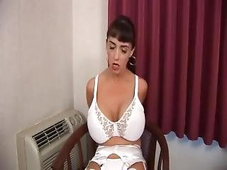 Woman In Hotel Room On Chair