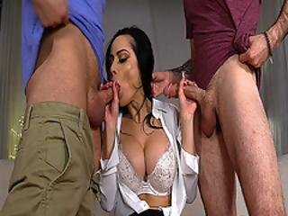 Crystal Rush Gobbles Two Huge Cocks Deep Down Her Throat