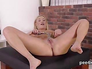 Exquisite Nympho Is Peeing And Pleasuring Shaven Vagina