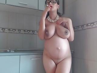 Pregnant Woman Smoking White Top In Kitchen
