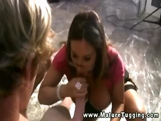 Busty Mature Milf In Threeway Tugging On Dick