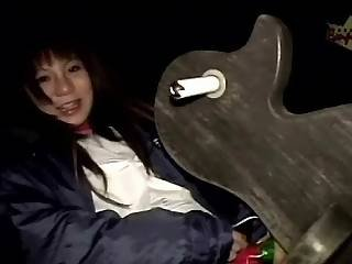Asian Girl On A Rocking Horse