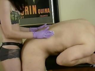 Mistress Mina Strapon With Purple Latex Gloves