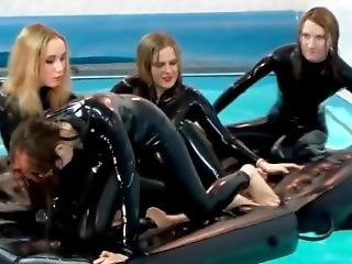 Girls In Latex Catsuit At The Pool