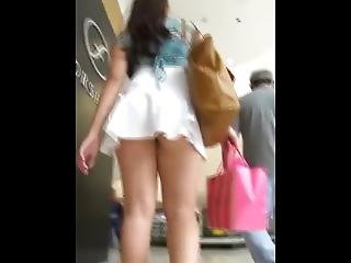 Teen In Miniskirt Showing Us Her Perfect Ass In Public