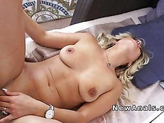 Blonde Takes Huge Dick Into Her Asshole In Patio