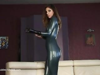 Sexy Model Stripping Off Her Latex Catsuit
