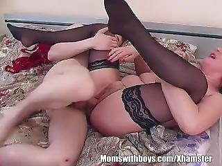 Hottie_brunette_stepmom_fucks_her_stepson_in_bed