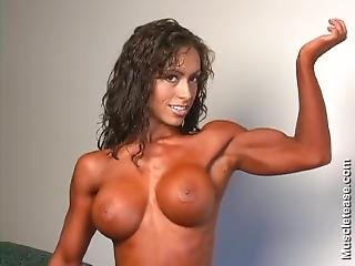 Topless Muscle Girl With Big Boobs Flexes Her Biceps