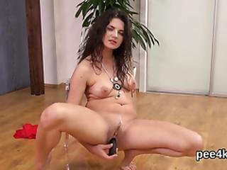 Stunning Teenie Is Pissing And Rubbing Shaven Snatch