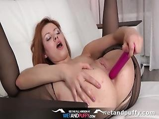 Wetandpuffy   Pantyhose Wearing Redhead Teases Her Puffy Pussy And Ass