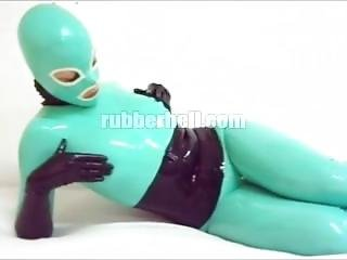 Jade And Black Rubber Doll In Total Latex Enclosure