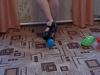 Girl Bursts Inflatable Balls With Her Big Ass And Masturbates