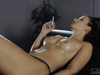 The Hot Girl Smokes A Cigarette And Shows Her Sexy Oiled Body.