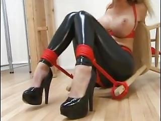 Busty Tied Up Blonde In Latex Pants And High Heels Shoes