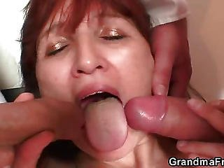 Mature Redhead Gobbling Up Two Dicks