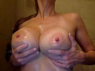 Blonde Sex Slave With Huge Tits Using Dildo In The Shower