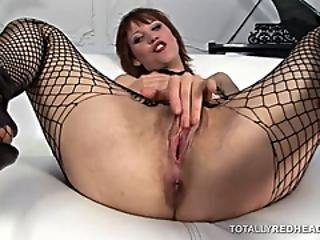 Redhead In Fishnet Gets Fingered