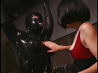 Seductive Mistress Plays In Hottie In Rubbersuit