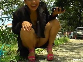 Pretty Amateur Latina Exhibitionist Plays With Her Pussy In A Public Street