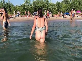 My Wife Showing Off Her Ass In A One Piece Thong