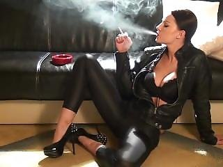 Sexy Abbie Smoking In Leather