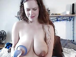 Camgirl Milking Her Tits With A Toy In Her Pussy