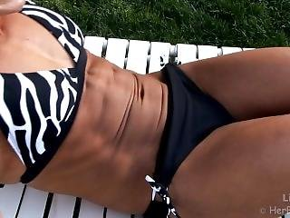 Fitness Girl In Bikini Does Abs Crunches