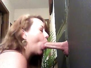 Wifey Sucks Cock At Gloryhole Party