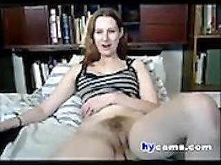 Horny Teen dildoing hairy pussy