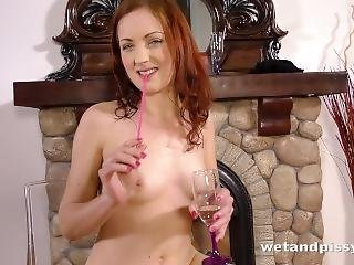 Long Haired Lady With A Glass Dildo