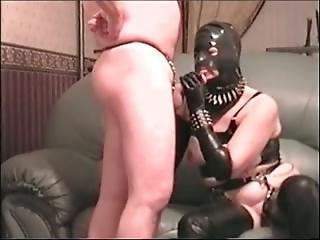 Rubber Woman Sucking Penis