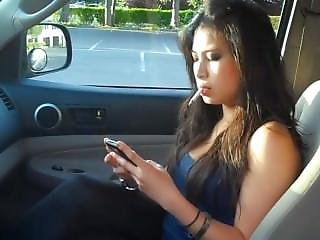 Beautiful Girl Smokes A Cigarette In A Car