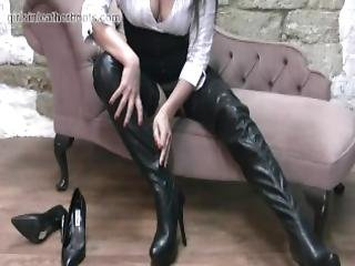 Hot Secretary Simone Gets Home From Work And Slowly Pulls On Her Leather Thigh Boots Over Her Sexy Nylon Stockings