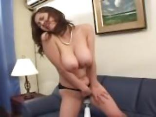Busty MILF trickles on the couch