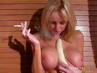 Huge Tits Smoking And Fucking Herself