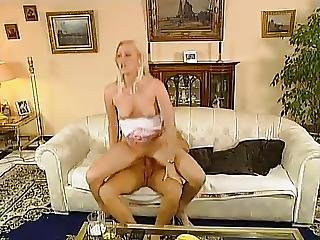 Blonde In Miniskirt Fucked On Couch