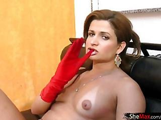 Hot T-babe In Red Fishnet Overall Strokes Cock While Smoking