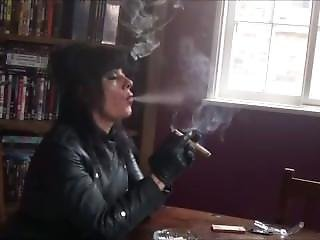 Leather Domme Smoking Cigar