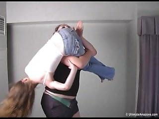 Tall Girl Lifts Small Girl