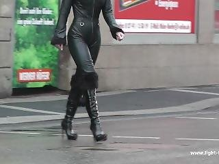 Landy Pantera In Leather Catsuit And Furry Boots Walking Outdoors