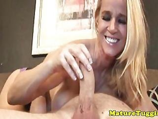 Busty Stepmom With Pierced Nipples Tugging On Cock