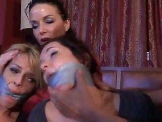 Two Girls Are Tied And Gaged With Duct Tape By Evil Woman And Man