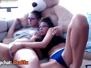 Busty Brunette Masturbating With Her Friend On Couch