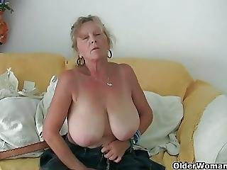 image British gilf dolly pushes a dildo up her fanny