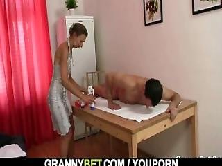 Granny Masseuse Loves Sucking And Riding His Young Cock