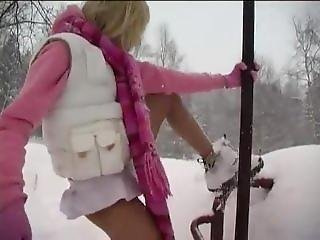 Blonde Teen Playing In The Snow