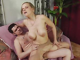 Busty Blonde In Stockings Gets Doggy Style Fuck