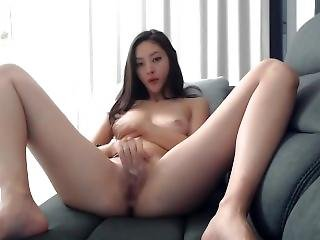 Asian Cam Girl Masturbates On The Couch