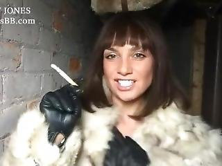 Smoking Brunette In Fur Coat Give Instructions